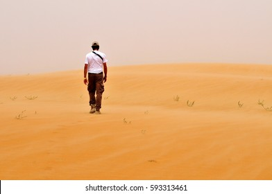 Run in desert, freedom conceptual; a man run away, alone, from trouble.