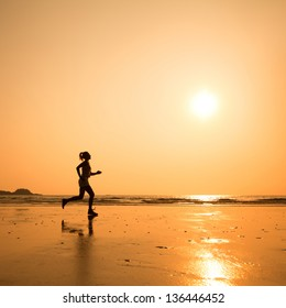 run to purpose, woman silhouette on the beach