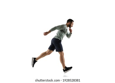 Run. Young caucasian male model in action, motion isolated on white background with copyspace. Concept of sport, movement, energy and dynamic, healthy lifestyle. Training, practicing. Authentic.