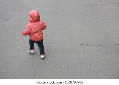 Runaway toddler. Toddler runs across the road. Kid running away