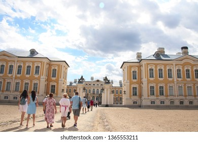 Rundale palace in Latvia. It is made in baroque style. Famous attraction place for tourists. Rundale palace in Latvia.Blue cloudy sky. It is made in baroque