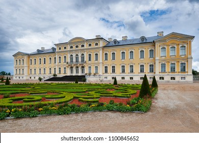Rundale palace in Latvia.Blue cloudy sky. It is made in baroque style. Famous attraction place for tourists.
