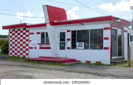 Rundown abandoned red and white roadside diner.