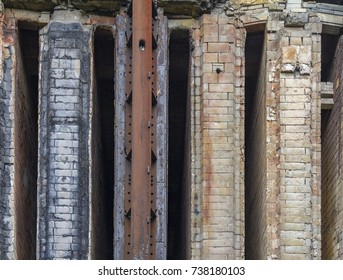 rundown industrial brick wall facade detail