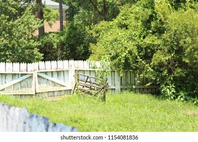rundown white picket fence