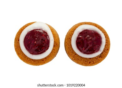 Runebergin torttu, famous Finnish Runeberg cake tart pastry made of almonds, rum, raspberry jam. Close up macro view of two caked isolated on white background. Baked on February 5, Runeberg's birthday