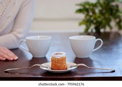 Runeberg's cake is a Finnish traditional dessert and pastry - Raspberry jam inside a sugar ring is commonly placed on top of the tart