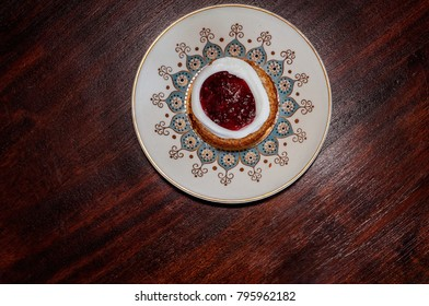 Runeberg's cake is a Finnish traditional dessert and pastry - Raspberry jam inside a sugar ring is commonly placed on top of the tart, a hand made traditional dessert from Finland