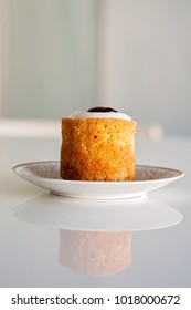 Runeberg's tart or cake is a Finnish traditional dessert and pastry that is originally made of gingerbread and bread crumbs, almonds, while rasberry jam and sugar on top