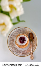 Runeberg's tart or cake is a Finnish traditional dessert and pastry, tulips on a foreground.