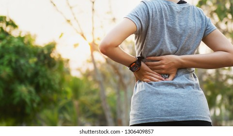 runer woman with back pain