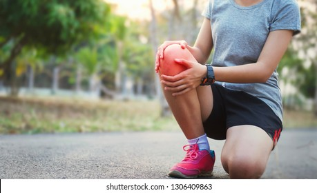 runer woman with knee injury and pain