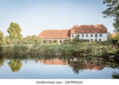 Rungstedlund, the home of the danish writer and storyteller Karen Blixen, reflections in the pund, Rungsted, Denmark, october 10, 2018