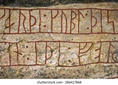 Runic inscriptions on a runestone in Ljungby, Sweden