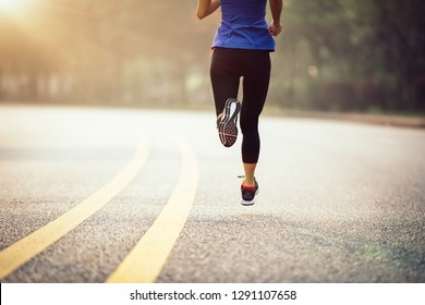 Runner athlete running on road. woman fitness  jogging  workout wellness concept