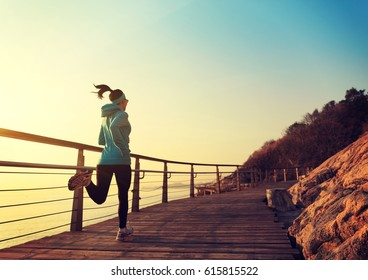 Runner athlete running at seaside. woman fitness jogging workout wellness concept