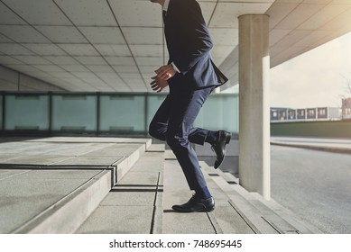 Runner businessman hurrying to office. Horizontal outdoors shot