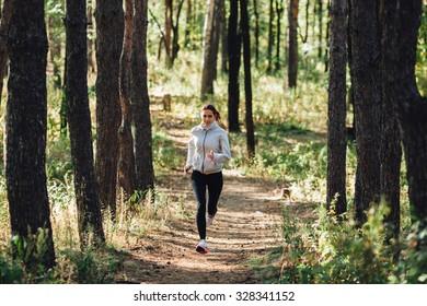runner caucasian woman jogging in autumn park
