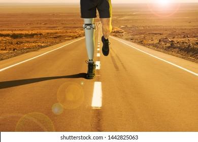 A runner crossing the desert with an orthopedic leg of
