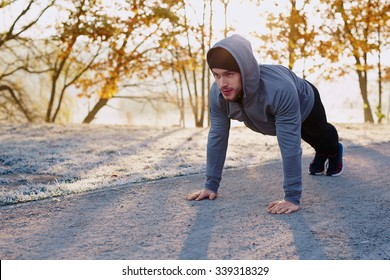 Runner doing pushups during morning workout - healthy lifestyle concept