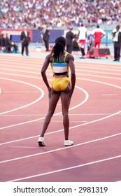 The Runner - Elite female runner waiting for the start of her event at international meet.