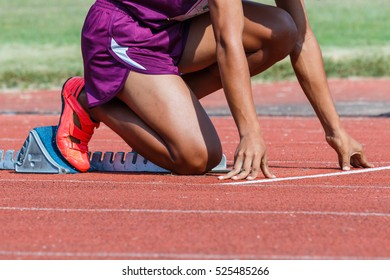 Runner feet on track -sprint start in track.