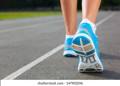 Runner Feet Running on Stadium Closeup - outdoor shot