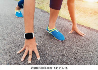 runner gesture ready start to run on road