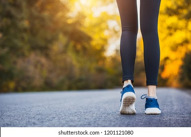 Runner legs on road in the morning workout. healthy lifestyle concept