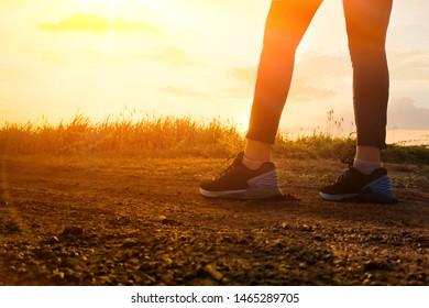 runner legs running in sunset