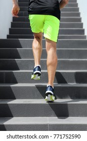 Runner man athlete running up the stairs on hiit high intensity interval training city run. Jogging jogger climbing staircase sprinting with speed. Urban active lifestyle. Closeup of legs and shoes.