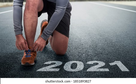 Runner man prepares to run on the 2021 line. Happy New Year 2021