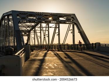 Runner on the John Seigenthaler pedestrian bridge or Shelby street crossing leaving downtown Nashville Tennessee