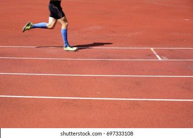 Runner on the running track symbol for reaching the goal