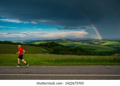 Runner and rainbow, training in summer nature