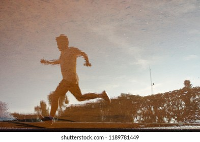 a runner reflection on water