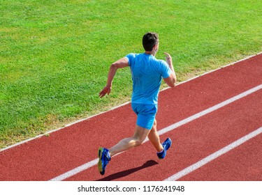 Runner sporty shape in motion. Athlete run stadium green grass background. Life non stop motion. Sport lifestyle and health concept. Man athlete run to achieve great result. Impulse to move.