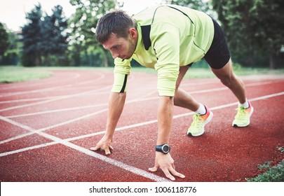 Runner in starting position. Sport, fitness, athletics concept