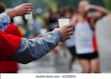 Runner take a water in a marathon race