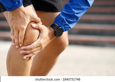 Runner touching painful twisted or broken. Athlete training, running up and down stairs accident. Sport sprained sprain cause injury knee. and pain with leg bones.