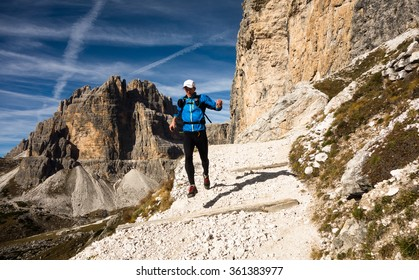 runner training in Italian Dolomites on a rocky trail