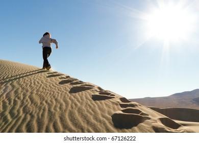 Runner Training on Dune Appreciating Nature