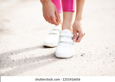 Runner trying running shoes getting ready for run. Healthy lifestyle.