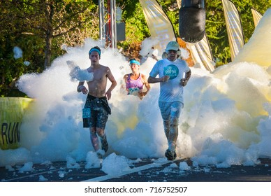 Runner wading through the yellow bubble bog. Bubble Run a charity fundraiser in Everett Washington, August 2017