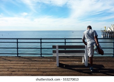 A runner is warming up at a balcony by the sea