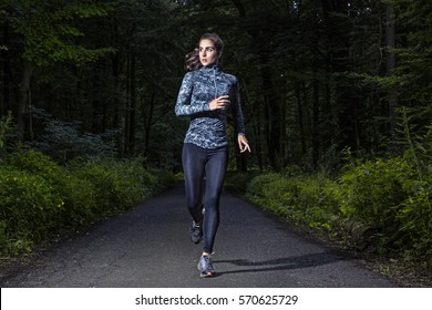 Runner woman in a dark forest