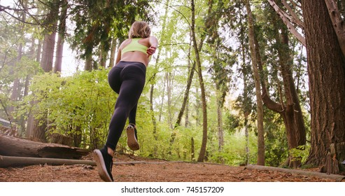 Runner Woman running In Woods Exercising Outdoors sprint