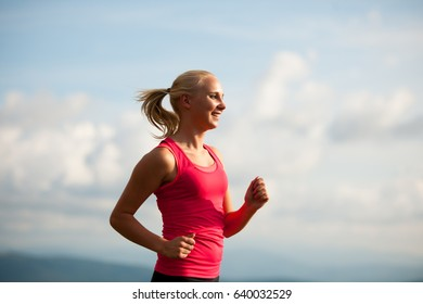 runner - woman runs cross country on a path in early autumn