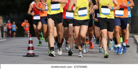 runners during the marathon without bib number and no brand and logos