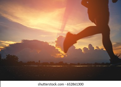Runner's Feet, Motion Blurred runner closeup shot  runner running at a fast pace background clouds sky sunlight